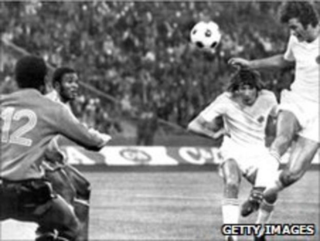 Yugoslavia's Dusan Bajevic (right) heads home past Zairean goalkeeper Dimbi Tubilandu