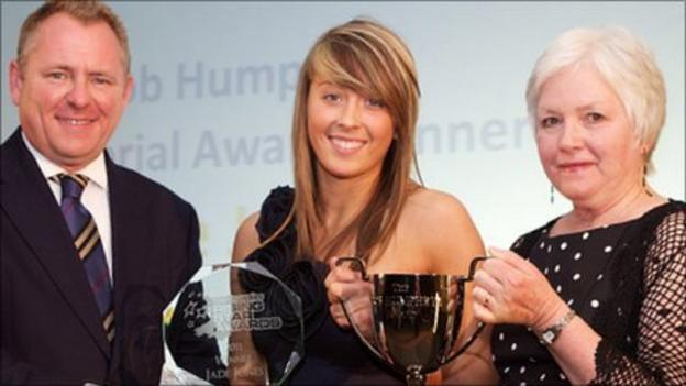 Jade Jones is presented with the Bob Humphrys Award by BBC Wales' Jamie Owen and Bob's widow, Julie Humphrys