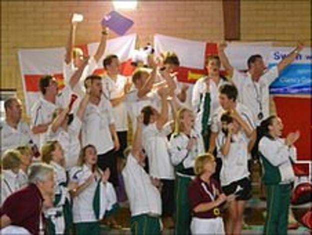 Guernsey swimmers celebrate another medal at the pool in the Isle of Wight