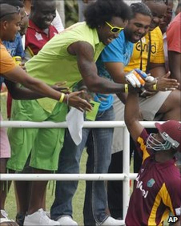 Chris Gayle shakes hands with Marlon Samuels