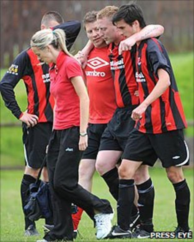Crusaders player Chris Morrow is helped off during the game against Larne