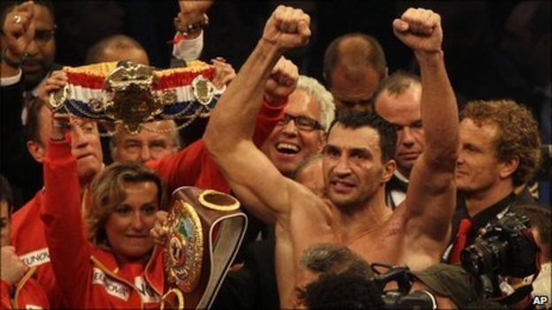 Klitschko raises his hands aloft in triumph after winning the fight
