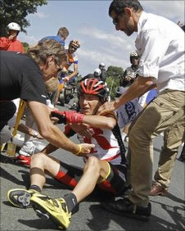 Janez Brajkovic of Slovenia is treated after crashing