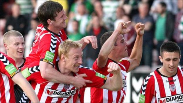 Derry team-mates celebrate with Daniel Lafferty (right) after his goal