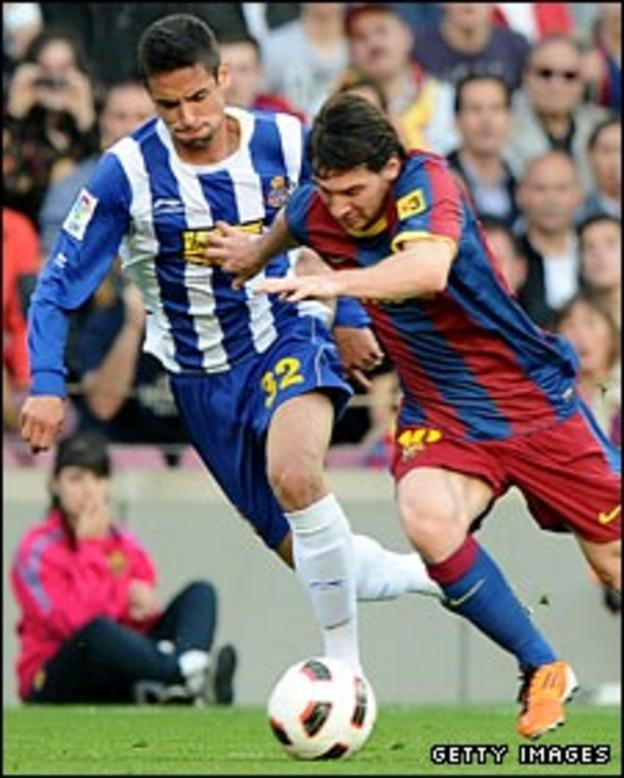 Raul Rodriguez chases Barcelona's Lionel Messi