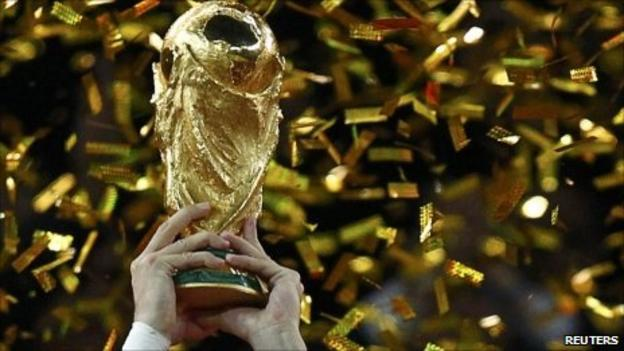 Gerard Pique of Spain holds the Fifa World Cup trophy after the 2010 World Cup final
