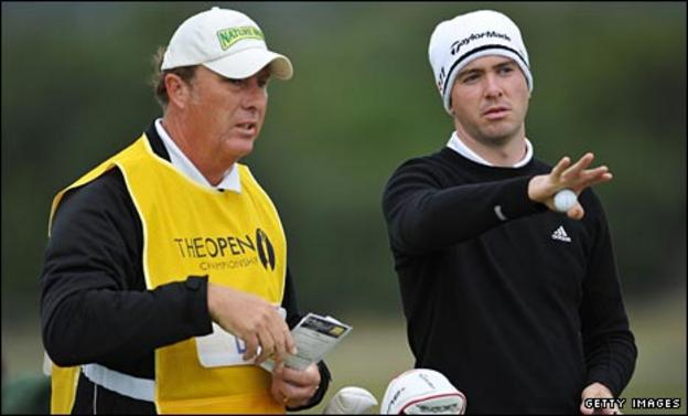 Martin Laird discusses with his caddie