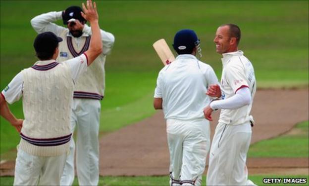Charl Willoughby (right) celebrates the wicket of Gautam Gambhir