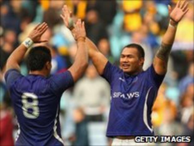 George Stowers and Taiasina Tuifu'a celebrate Samoa's victory