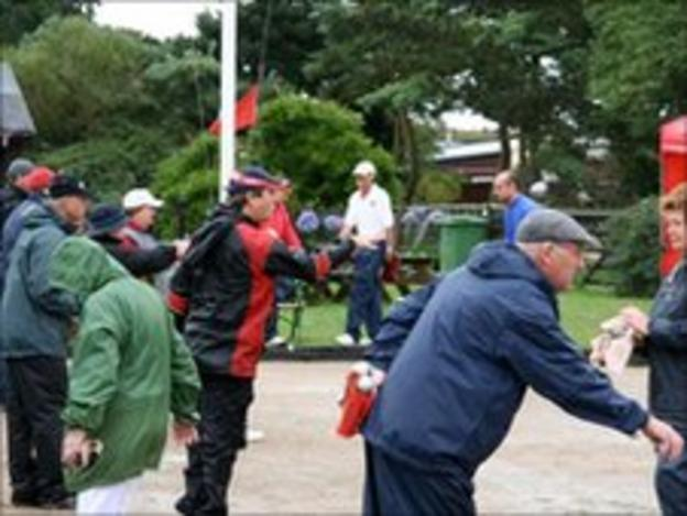 Petanque players in action