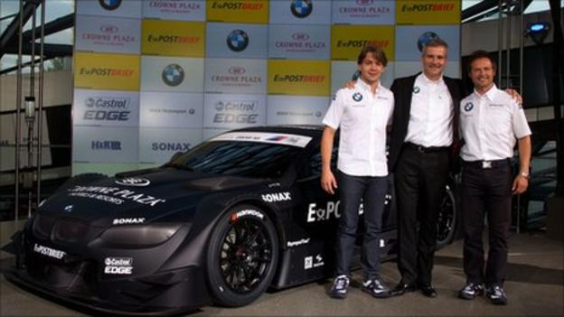 Andy Priaulx (right) alongside the 2012 BMW DTM car