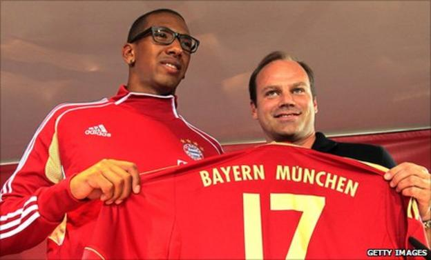 New Bayern Munich signing Jerome Boateng (left) with the club's sporting director Christian Nerlinger. Boateng has joined from Manchester City.