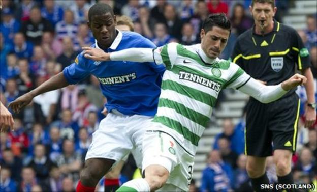 Rangers midfielder Maurice Edu and Celtic midfielder Beram Kayal