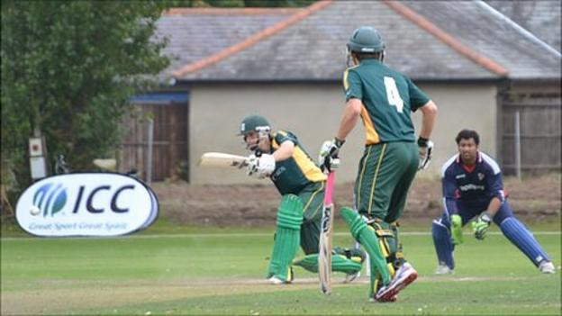 Guernsey cricketer Tim Ravenscroft batting in partnership with Ross Kneller against Norway