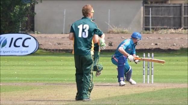 Guernsey cricketer Tim Ravenscroft bowls out an Austrian player