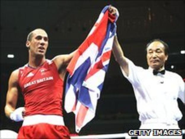 Britain's James DeGale (left) is awarded victory in Beijing