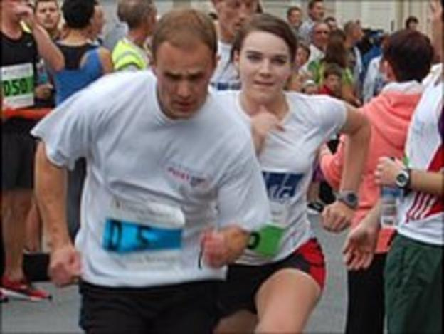 Town Relay: James De Garis from Guernsey Post and Sarah Mercier from KPMG A
