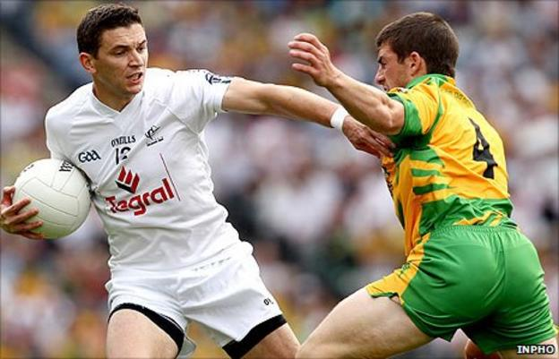 Kildare's Eamonn Callaghan fends off the challenge of Donegal opponent Paddy McGrath