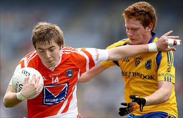Armagh's Paul McGeown holds off the challenge of Roscommon opponent David O'Dowd