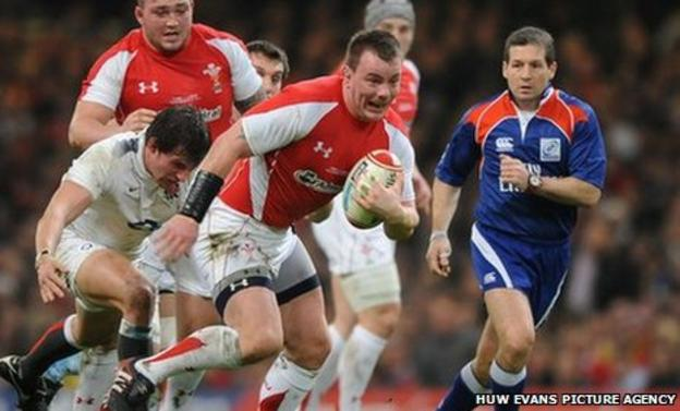 Matthew Rees gets away from Tom Wood of England during the Six Nations