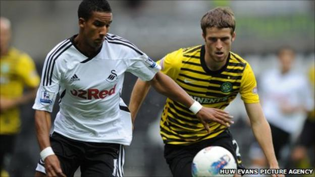 Swansea's Scott Sinclair holds off Celtic defender Adam Matthews