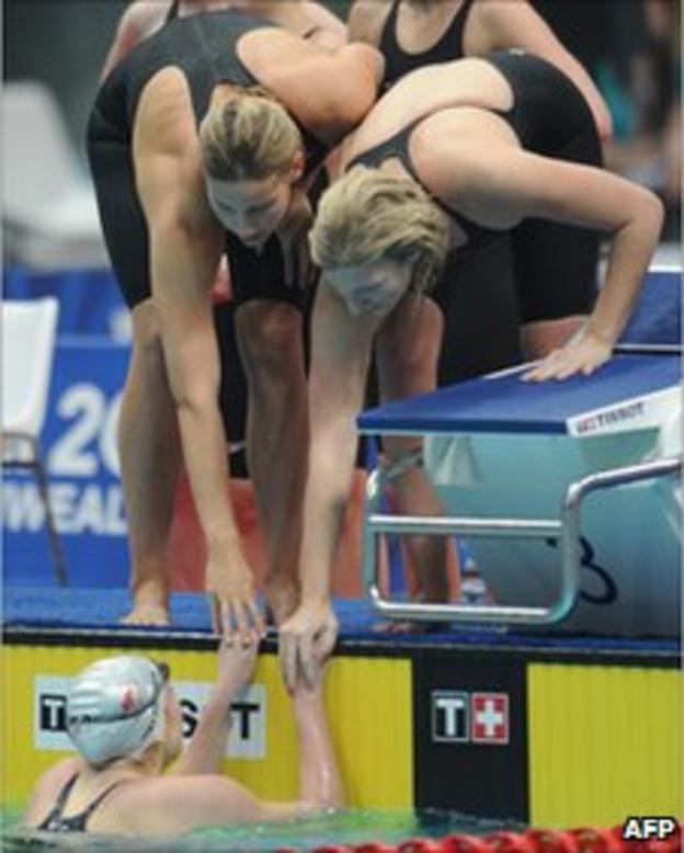 Rebecca Adlington congratulates Sasha Matthews during the Commonwealth Games 2010