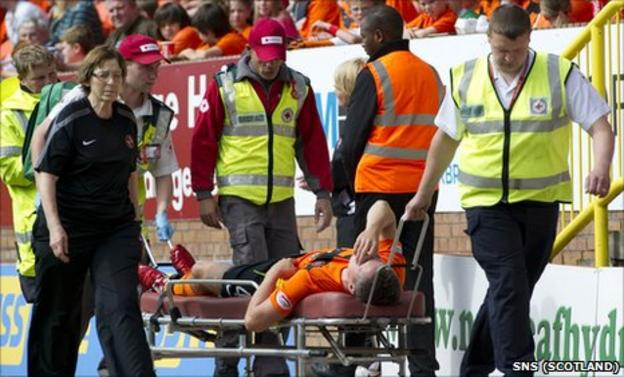 Scott Severin is stretchered off the pitch after sustaining an injury