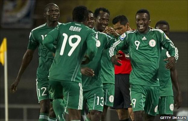 Olarenwaju Kayode (number 9) and his team-mates celebrate