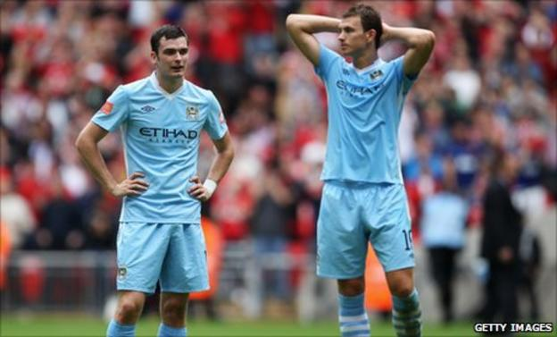 Manchester City players Adam Johnson and Edin Dzeko