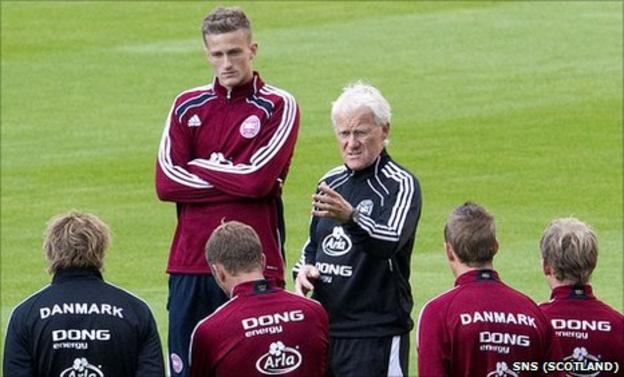 Denmark coach Morten Olsen speaks to his players at training