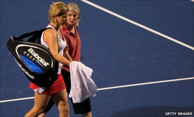 Kim Clijsters leaves the court with a WTA physio