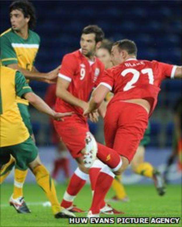 Darcy Blake heads his first goal for Wales
