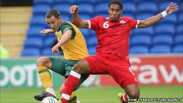 Wales' Ashley Williams and Australia's Scott McDonald compete for the ball