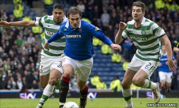 Emilio Izaguirre and Charlie Mulgrew in action against Rangers