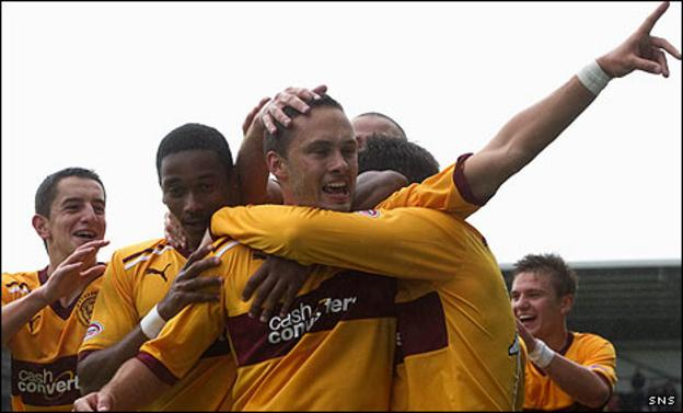 Tom Hateley is mobbed by team-mates after his late winner for Motherwell
