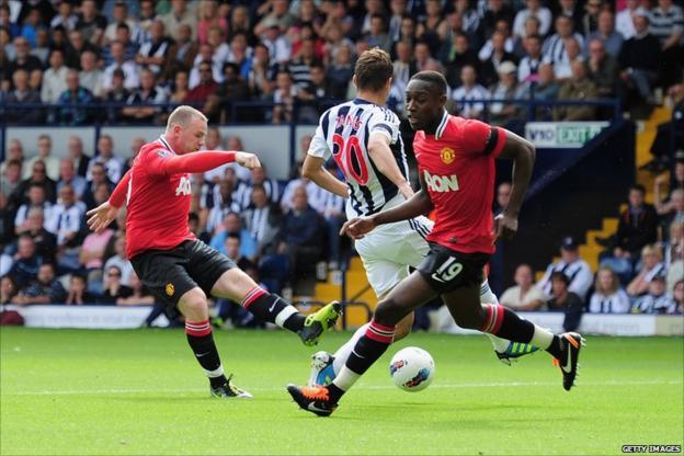 Wayne Rooney (left) scores for Manchester United