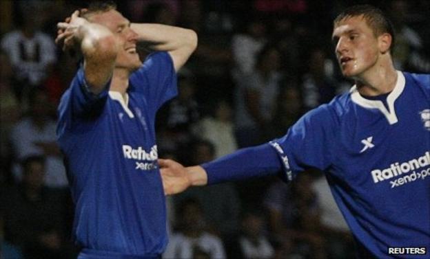 Birmingham's Stephen Caldwell (left) reacts next to team-mate Chris Wood