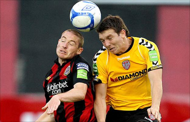 Glenn Cronin of Bohemians goes up for a high ball with Derry City's Kevin Deery