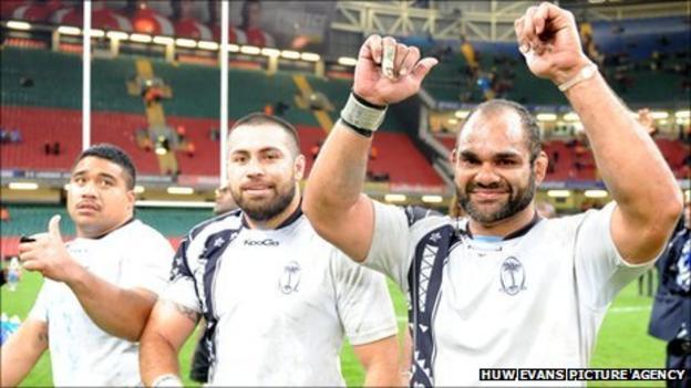 Deacon Manu (right) celebrates Fiji's draw with Wales in November 2010