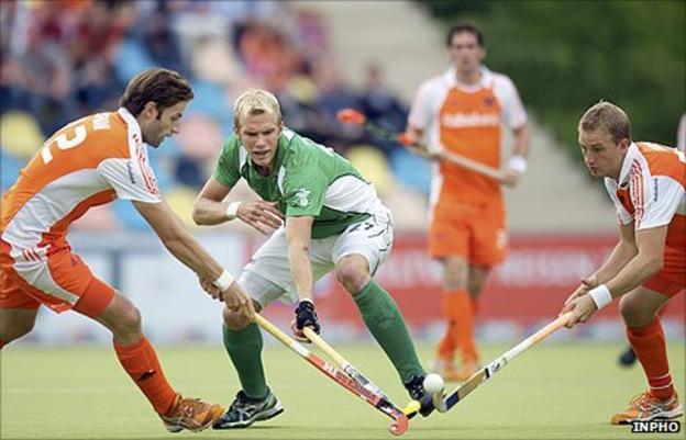 Rogier Hofman and Billy Bakker of the Netherlands close in on Ireland's Conor Harte