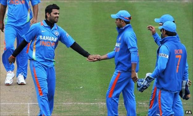 RP Singh (left) is congratulated after taking one of his four wickets