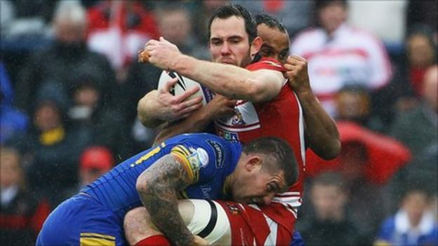 Pat Richards tries to keep hold of the ball