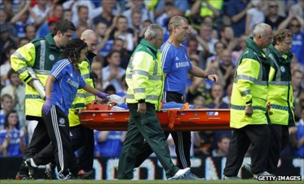 Drogba gets carried off the pitch