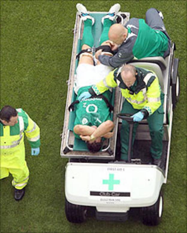 David Wallace is taken off the pitch after being injured