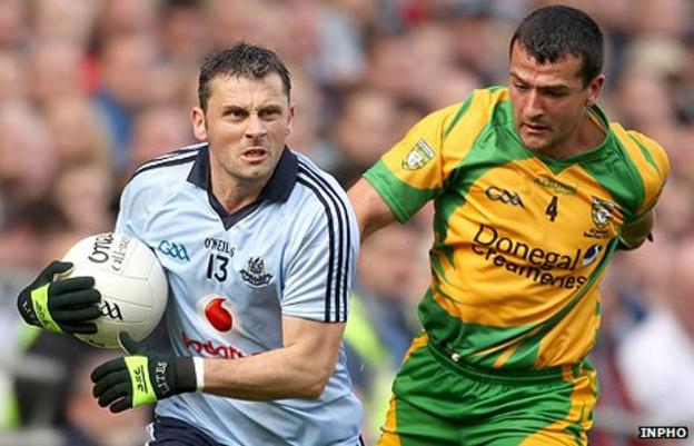 Alan Brogan in possession against Donegal opponent Frank McGlynn