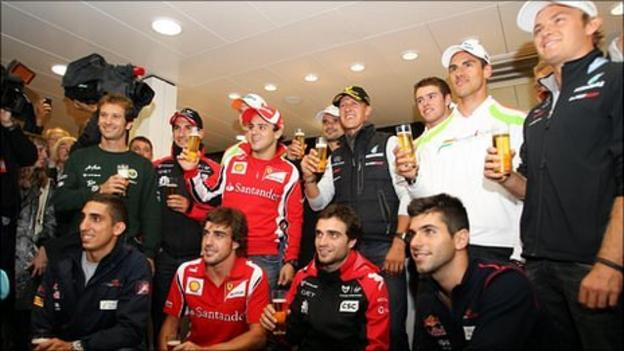 Michael Schumacher (centre) and his fellow F1 drivers celebrate his 20 years in the sport