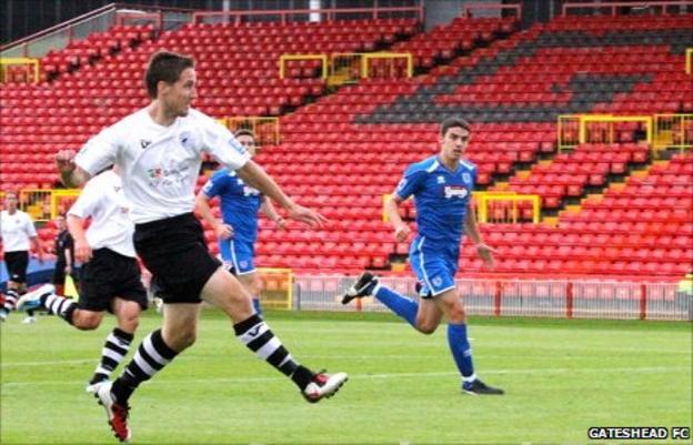 Jon Shaw shoots against Grimsby