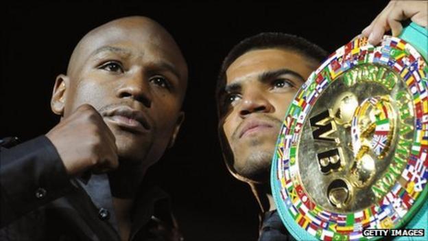 Floyd Mayweather (left) and Victor Ortiz