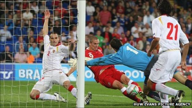 Wales striker Steve Morison slides in to score his first international goal