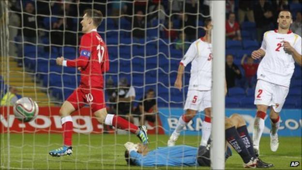 Captain Aaron Ramsey peels away after doubling Wales' lead against Montenegro